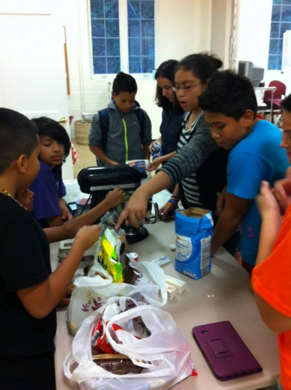Teens Club Core works together to make cookies