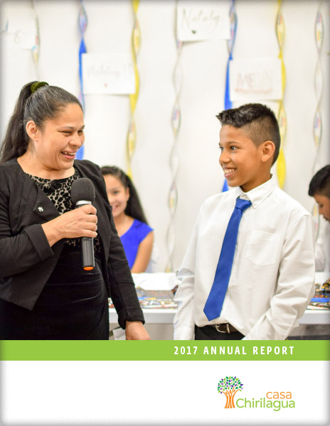 Cover of Casa Chirilagua annual report, featuring student and his mother